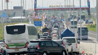 four lanes of traffic backed up all the way to a junction in Indonesia