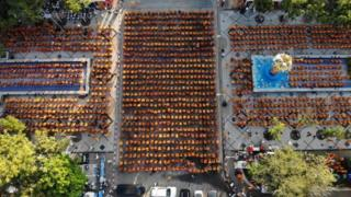 in_pictures Buddhist monks gather for a mass prayer one week after a lone soldier shot and killed 29 people in Thailand