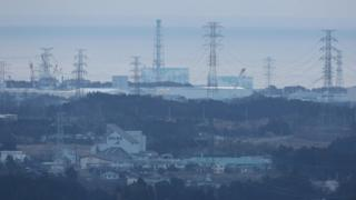 View of Fukushima nuclear plant from a nearby town