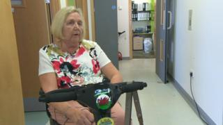 Patient Euryl James sitting on a mobility scooter in a hospital corridor