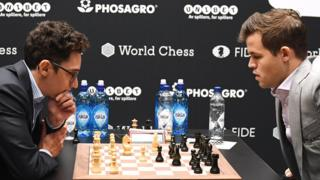 Norway's World Chess Champion Magnus Carlsen (R) plays against US challenger Fabiano Caruana (L) at the Round Ten game during the World Chess Championship 2018 in London, Britain, 22 November 2018.