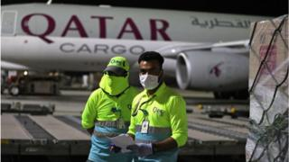 Supplies to tackle the coronavirus pandemic are loaded onto a Qatar Airways flight.