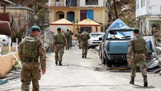Soldiers in Tortola in the British Virgin Isles where homes are devastated