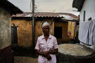 Eva Nah pictured outside her house in West Point, Monrovia, Liberia.
