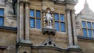 Rhodes's statue stands on the building named after him at Oriel College, Oxford