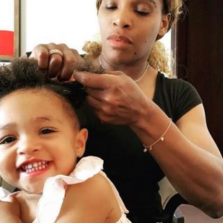 Serena Williams plaiting her daughter Olympia's hair