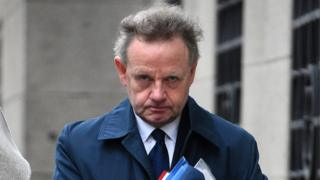 Andy Hill arriving at court on first day of defence - 13/2/19