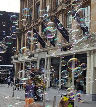 Man blowing bubbles in Glasgow