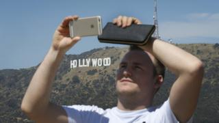 science A tourist enjoys the view of the Hollywood sign