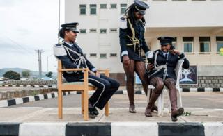 Female members of a brass band chat and rest before the inauguration of the Tibebe Ghion Specialised Hospital in Bahir Dar, Ethiopia - Saturday 10 November 2018