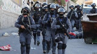 Israeli police patrol a neighbourhood in Jerusalem