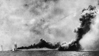 This picture shows the HMS Lion (left) is shelled and HMS Queen Mary, (right) is blown up by German shells during the Battle of Jutland