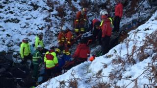 Rescuers lift a victim up a gully at New Radnor