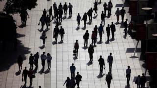 Pedestrians in central Shanghai (file photo - April 2013)