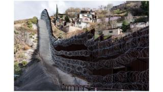 A border wall divides Nogales, Arizona from the Mexican state of Sonora