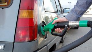 Man fills car with petrol