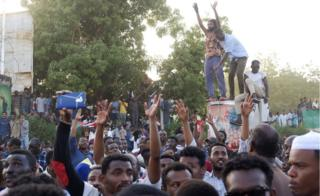 Demonstrators at a sit-in at the military HQ in Khartoum, Sudan - Monday 8 April 2019