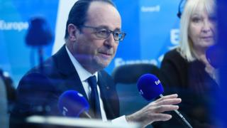 France's President Francois Hollande (L) speaks during a morning radio show on Europe 1 station on 17 May 2016 in Paris