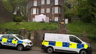 Police vehicles outside house on Hitchin Road, Luton