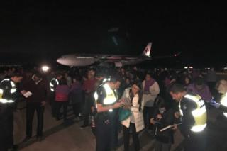 Passengers were evacuated on to the tarmac after a long wait