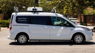 A picture of a white van with camera equipment on the roof and 'Apple Maps' written on it