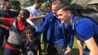 Everton players pose for a selfie with fans in Tanzania