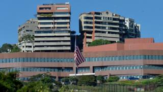 Image shows the entrance of the embassy of the United States in Caracas