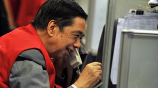 smiling HK trader