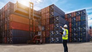 Man standing at container port