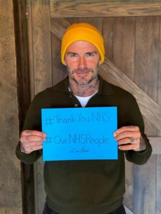 david beckham with a thank you NHS sign