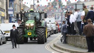 Tractor pulling coffin