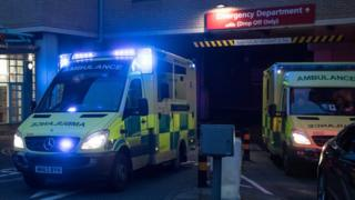 A ambulance leaves the Accident and Emergency department of the Bristol Royal Infirmary