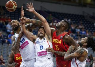JULY 05: Reggie Moore (R) of Angola competes for the ball against Angel Vassallo Colon (C) and Peter Ramos (L) of Puerto Rico during the 2016 FIBA World Olympic Qualifying basketball Group A match between Puerto Rico and Angola