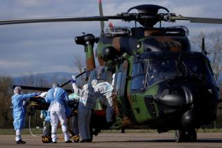 A patient being loaded into a helicopter