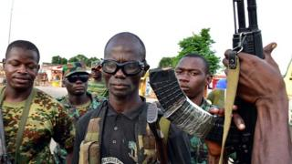 Mutinous soldier pose with their weapons in the streets of Ivory Coast's central second city Bouake