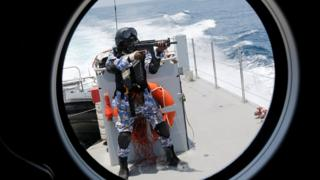 A member of the Ivory Coast Navy takes part in a multinational naval exercise off the coast of Abidjan, Ivory Coast