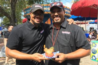 Brothers, Brent and Juan Reaves from Smokey John's BBQ, proud creators of Big Red Chicken Bread.