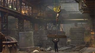 Worker casts steel ingot