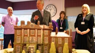 Prince Charles with chocolate model of Highgrove House