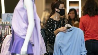 Shoppers wearing face coverings