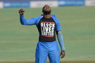 in_pictures Cricketer Andile Phehlukwayo raises a fist and displays his Black Lives Matter T-shirt.