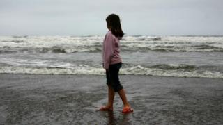 Child by sea