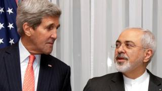 John Kerry and Mohammad Javad Zarif stand next to each other at nuclear talks in Lausanne, Switzerland (16 March 2015)