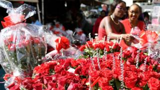 Bouquets of roses are for sale for Valentine's Day at a flower shop in Nairobi on February 14, 2018.