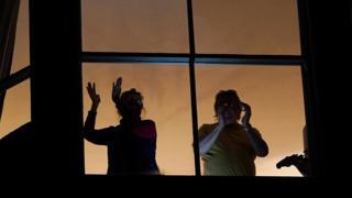 People applauding from balconies