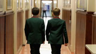 Two boys walking down a corridor at Altrincham Grammar School