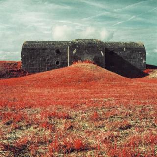 Infrared photograph of a bunker, surrounded by grass