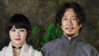 Zhang Hanyun standing beside Zhao Lixin