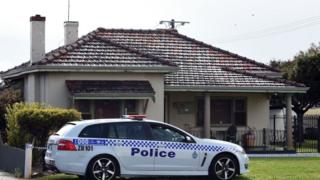 A police car outside a house in Perth where the five victims were found