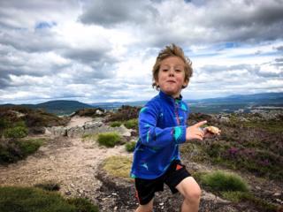 Calum eating a pork pie as he ran up Craigellachie
